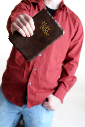 Christian-young-man-holding-bible
